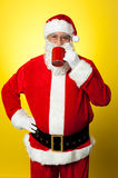 Portrait of a aged Santa sipping coffee Royalty Free Stock Photo