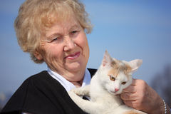 Portrait of aged woman with cat Stock Photo