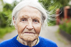 Portrait of an aged woman smiling outdoors Stock Photography