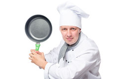 Portrait of aggressive evil chefs with frying pan. On a white background Stock Photo