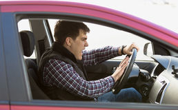 Portrait of aggressive male driver honking in traffic jam Royalty Free Stock Photography