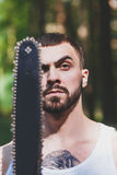 Portrait of aggressive muscular male lumberjack Royalty Free Stock Image