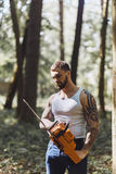 Portrait of aggressive muscular male lumberjack Stock Photography