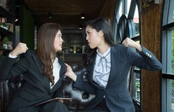 Portrait of Aggressive young Asian woman in formal wear or businesswoman fight/Coworkers fighting. Portrait of Aggressive young Asian women in formal wear or Stock Photos