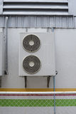 Portrait of air conditioner units on wall outside building Royalty Free Stock Photos