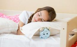 Closeup portrait of alarm clock lying under pillow in teenage girl bedroom. Portrait of alarm clock lying under pillow in teenage girl bedroom Stock Photos