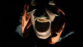 Portrait of alight vampire face scaring at night. In full HD stock footage