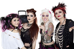 Portrait of all female band with microphone and boom box over white background Stock Photo