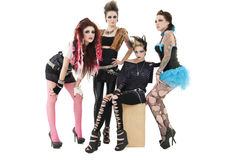 Portrait of all female rock band over posing together over white background Royalty Free Stock Images