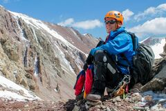 Portrait of alpinist in helmet in the high mountains