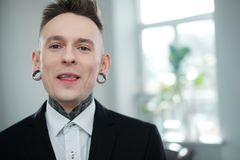 Portrait of alternative model with earplugs and tattoo stock photos