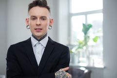 Portrait of alternative model with earplugs and tattoo.  royalty free stock photography