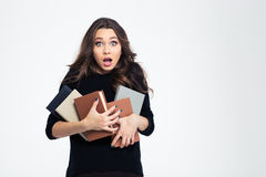 Portrait of amazed female student holding books Stock Images
