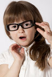 A portrait of the amazed girl. Wearing glasses Royalty Free Stock Photo
