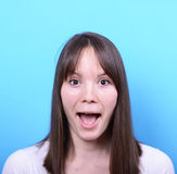 Portrait of amazed girl against blue background Royalty Free Stock Photo
