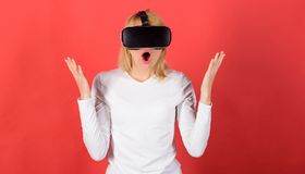 Portrait of an amazed girl using a virtual reality headset isolated on red background. Person with virtual reality. Helmet. Woman using virtual reality headset stock images