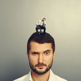 Portrait of amazed man with bored man. On the head Stock Photo