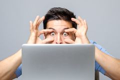 Portrait of amazed man with laptop computer Royalty Free Stock Photography