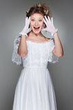 Portrait of amazed woman in white dress Royalty Free Stock Image