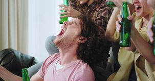 Portrait of amazing attractive guy with curly hair with his friends multi ethnic celebrating excited victory of their. Football team yelling cheers and clapping stock footage