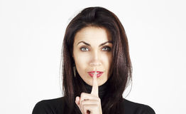 Portrait of amazingly sexy beautiful young woman saying shh Royalty Free Stock Photos