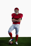 Portrait of american football player with arms crossed Royalty Free Stock Photography