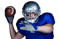 Portrait  of American football player with ball playing Stock Photo