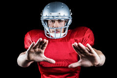 Portrait of American football player defending Stock Photo