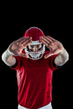Portrait of american football player protecting himself Royalty Free Stock Photo