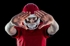 Portrait of american football player protecting himself Royalty Free Stock Photography