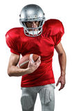 Portrait of American football player in red jersey running with ball Stock Image