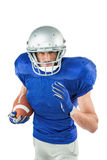 Portrait of American football player running with ball Royalty Free Stock Photos