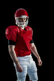 Portrait of american football player wearing his helmet Royalty Free Stock Photography