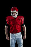 Portrait of american football player wearing his helmet Royalty Free Stock Photo