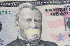 Portrait of the American leader Ulysses Grant with mouth glued on the banknote of fifty dollars USA Stock Photography