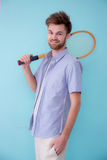 Portrait of american man standing sports with tennis racket. Stock Images