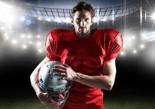 Portrait of american player standing with helmet in stadium Stock Image