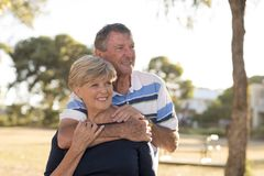 Portrait of American senior beautiful and happy mature couple ar royalty free stock images