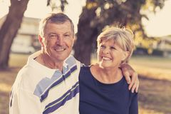 Vintage filter portrait of American senior beautiful and happy mature couple around 70 years old showing love and affection smilin. Portrait of American senior Royalty Free Stock Images