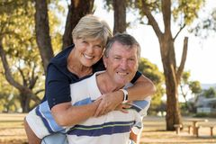 Portrait of American senior beautiful and happy mature couple around 70 years old showing love and affection smiling together in t royalty free stock image
