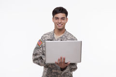 Portrait of an American soldier with a laptop Stock Photos