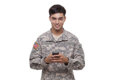 Portrait of an American soldier texting with a cell phone Royalty Free Stock Image