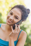 Portrait of amused young woman phoning Royalty Free Stock Images