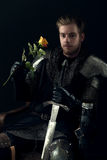 Portrait of ancient knight. With yellow rose Stock Photography