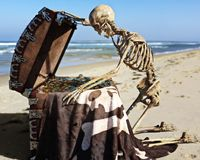 Portrait of an ancient skeleton opening a pirate treasure chest . Portrait of an ancient skeleton opening a pirate treasure chest with amazement off the coast Stock Photos