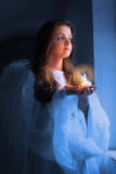 Portrait of an angel with a candle Royalty Free Stock Images