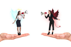 Portrait of angel and devil girls Royalty Free Stock Images