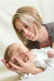 Portrait of angelic baby and his mother Stock Photos