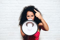 Woman Shouting Screaming Yelling With Megaphone For Protest Rebellion Strike royalty free stock photos