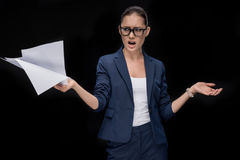 Portrait of angry asian businesswoman holding documents royalty free stock photos